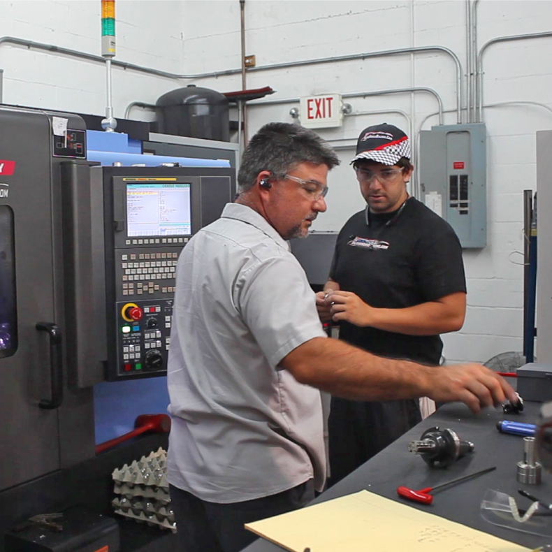 Two People working in manufacturing in Brevard Florida